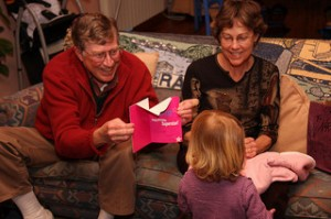 Family enjoying a birthday card.